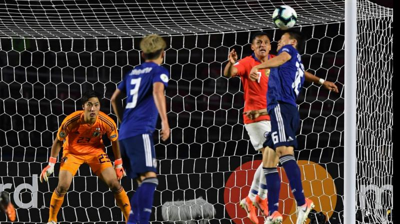 Alexis Sanchez found the net with a header in the 82nd, and Vargas closed the scoring about a minute later with a long lob shot over goalkeeper Keisuke Osako as he charged from his net. (Photo:AFP)