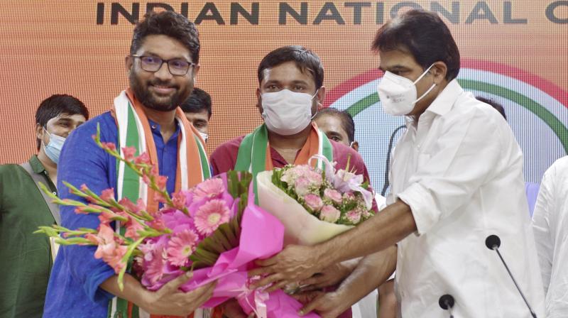 : Rajya Sabha MP KC Venugopal felicitates newly joined Congress member Kanhaiya Kumar and MLA Jignesh Mewani, who extended his support to the party, at AICC in New Delhi, Tuesday, Sep. 28, 2021. (PTI Photo/Vijay Verma)