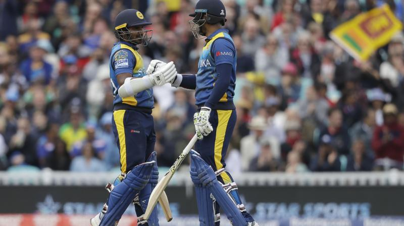 Dimuth Karunaratne and Kusal Perera both hit half-centuries in a swashbuckling opening partnership of 115 before Perera was bowled by Mitchell Starc. (Photo: AP)