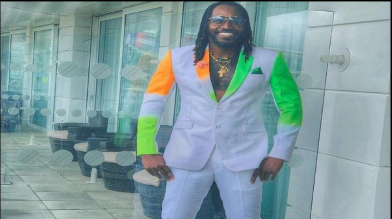 Gayle shared a picture of himself donning a white suit with patches of orange and green with a grey patch in between on one side of the outfit (Photo: Cricket World Cup/ Twitter)