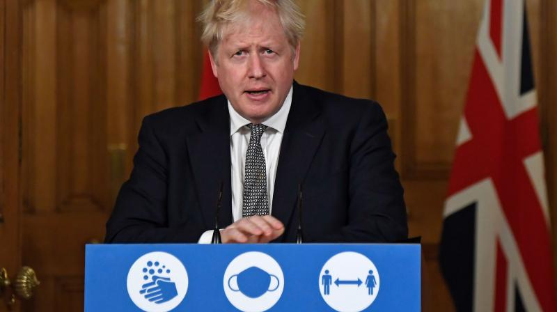 Britain's Prime Minister Boris Johnson speaks during a virtual press conference inside 10 Downing Street in central London on October 31, 2020 to announce new lockdown restrictions in an effort to curb rising infections of the novel coronavirus. (AFP)