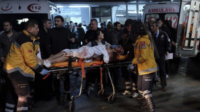 escue and medics carry a wounded person after attacks in Istanbul, late Saturday. (Photo: AP)