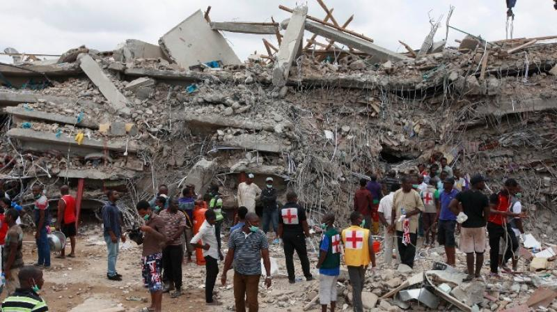 Rescue workers gather at the site of a collapsed building belonging to the Synagogue Church of All Nations in Lagos, Nigeria. (Photo: AP)