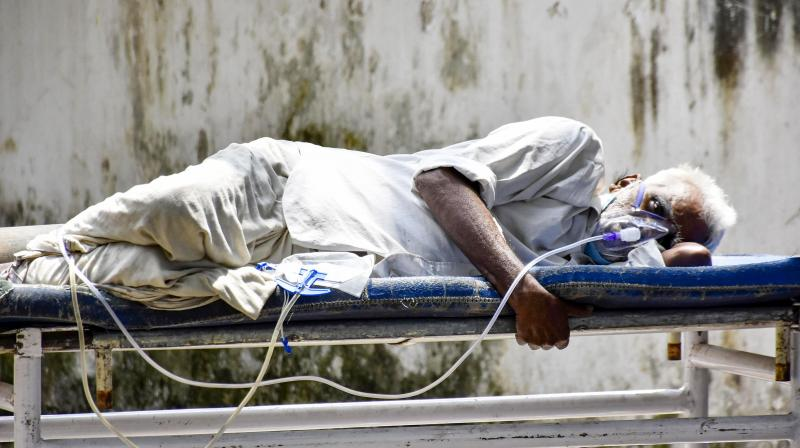 A file photo of COVID-19 patient on oxygen support waits to be admitted at Patna Medical College and Hospital, during the second wave of coronavirus in Patna. (PTI)