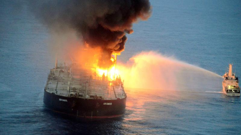 Indian coast guard ship (R) battling to extinguish the fire from the Panamanian-registered crude oil tanker New Diamond, some 60 km off Sri Lanka's eastern coast. Indian warships on September 3 aided Sri Lanka's navy to extinguish a fire on a massive oil tanker off the island's eastern coast, officials said.(AFP)