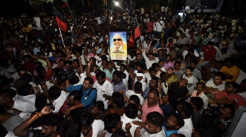 DMK supporters gather outside the hospital where M Karunanidhi is being treated, in Chennai. (Photo: PTI)