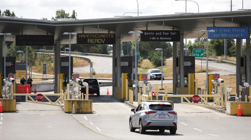 In this file photo taken on August 9, 2021 a vehicle approaches the USA-Canada border to enter the USA, which is still closed to Canadians for non-essential travel. (Jason Redmond / AFP)