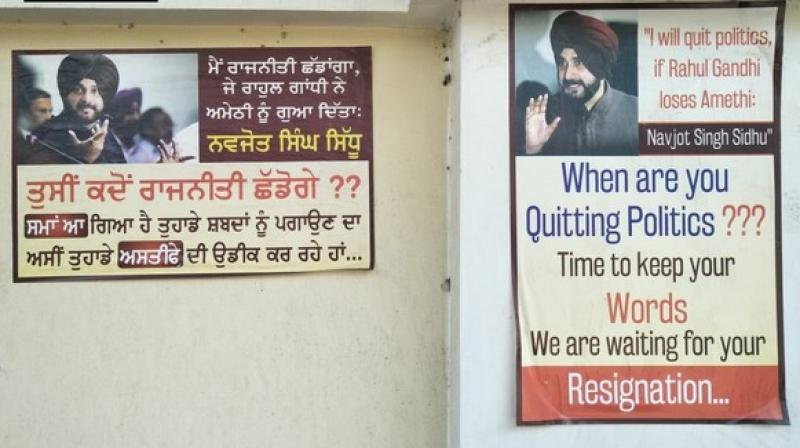 The posters with a picture of Sidhu and captioned read, 'When are you quitting politics? Time to keep your words. We are waiting for your resignation.' (Photo: ANI)