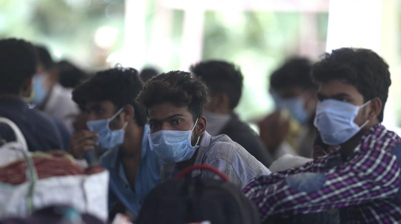 Migrant workers waits at a temporary shelter to register for free travel on a train, during lockdown to prevent the spread of new coronavirus on the outskirts of Hyderabad. AP Photo