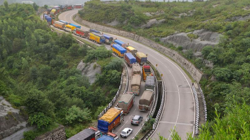 Vehicles move slowly during a traffic congestion on Jammu-Srinagar highway, in Jammu, Sunday. (PTI)