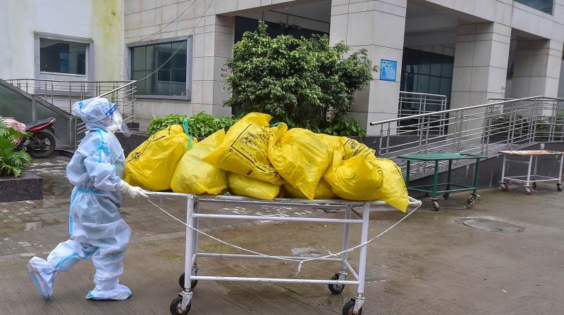 Medics carry medical waste at a Kolkata hospital. (PTI)