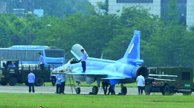 The JF-17 fighter jet with the Myanmar Air Force (MAF) logo emblazoned on its tail parked at a China airfield in Chengdu, where it has been conducting taxiing and flight tests since at least April 24. 2017.