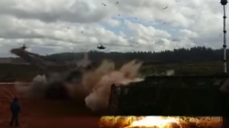 A video clip published on Tuesday by the independent news site Fontanka.ru showed a helicopter firing a salvo of rockets at a military truck covered in camouflage netting in open countryside, with three vehicles with no military markings visible, parked a few metres away. (YouTube/Screengrab/Fontanka.ru)