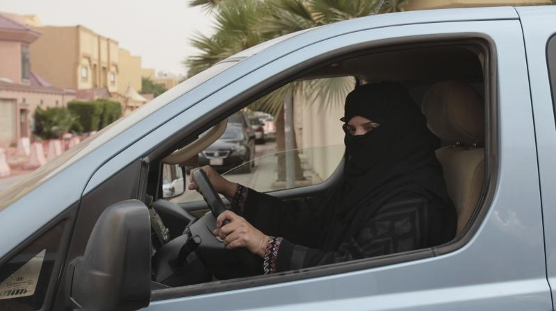 A woman drives a car in Riyadh, Saudi Arabia, as part of a campaign to defy Saudi Arabia's ban on women driving. (Photo: AP/File)