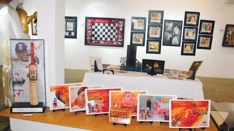 Sachin Tendulkar's signed bat, character posters from Sholay ( Photo: Mrugesh Bandiwadekar)