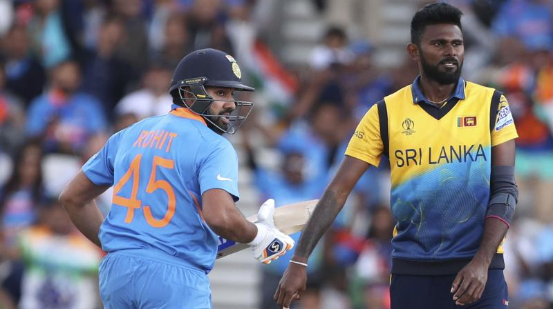 Rohit Sharma became the first player to smash five centuries in a World Cup after his 103 against Sri Lanka at Headingley to consolidate his position as this tournament's leading scorer. (Photo: AP)