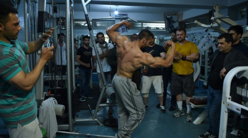 The scene inside this Kabul gym is repeated at venues all round the capital, where bodybuilding has become ubiquitous since the fall of the Taliban regime. (Photo: AFP)