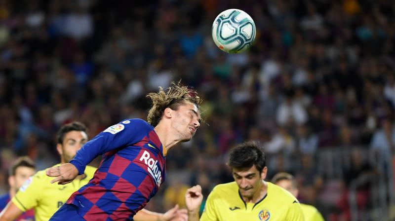 Antoine Griezmann headed Barcelona in front after six minutes, darting in at the near post to meet a Lionel Messi corner. (Photo:AFP)
