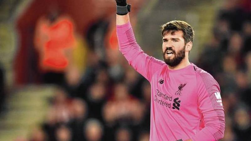 Liverpool goalkeeper Alisson Becker is back in full training and nearing a return to competitive action after six weeks out with a calf injury. (Photo:AFP)