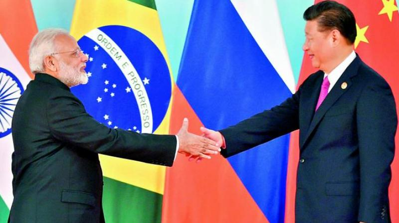 Prime Minister Narendra Modi and Chinese President Xi Jinping shake hands before the group photo session at 2017 Brics Summit in Xiamen, Fujian province in China, on Monday. (Photo: PTI)