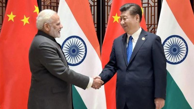 Prime Minister Narendra Modi meets the President of the People's Republic of China, Xi Jinping, on the sidelines of the 9th BRICS Summit, in Xiamen, China. (Photo: PTI)
