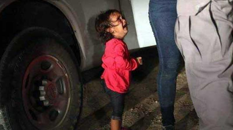 The picture of the wailing toddler was published worldwide and caused a public outcry about Washington's controversial policy to separate thousands of migrants and their children. (Photo: Facebook)