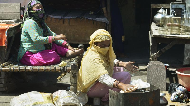 Gypsy women prepare lunch in their hut in New Delhi on April 4, 2020. (PTI)