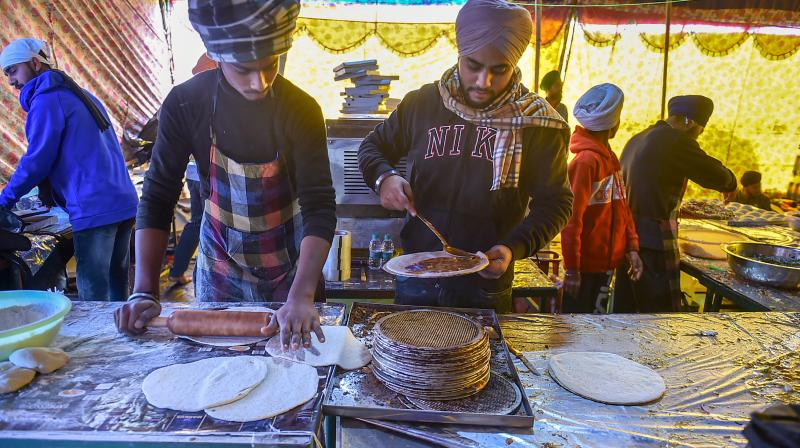 Langar being prepared for farmers during their ongoing protest against the new farm laws, at Singhu border in New Delhi on January 10, 2021. (PTI/Arun Sharma)