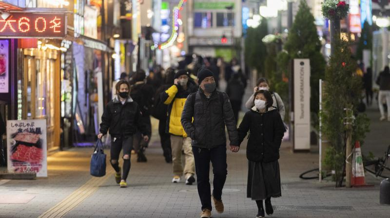 People walk around in the Shinjuku neighborhood of Tokyo on Thursday, January. 7, 2021, after Japanese Prime Minister Yoshihide Suga announced a state of emergency. Japan declared a state of emergency in Tokyo and three nearby prefectures, starting Friday as coronavirus cases continued to surge in the nation. (AP/Hiro Komae)