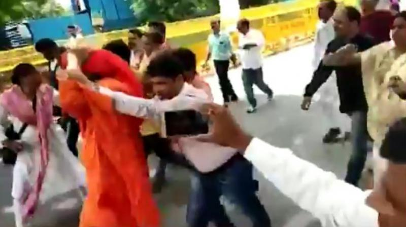 In a video that circulated on social media, the social activist is seen being chased and pushed by a group of people as he keeps walking and trying to get away. (Youtube Screengrab)