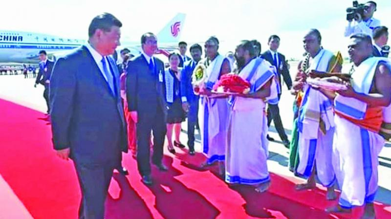 Chinese President Xi Jinping walking away from group of priests with poorna-kumbam at airport. 	(Photo: Asian Age)