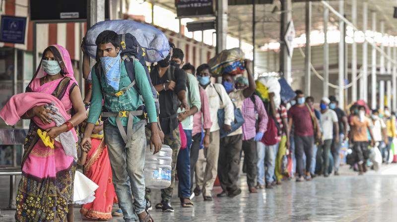 Migrants walk along a platform after deboarding a special train at Charbagh railway station, during the ongoing COVID-19 lockdown, in Lucknow. PTI Photo
