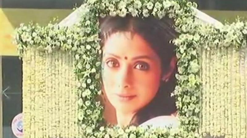 Sridevi was taken to a Mumbai crematorium in a flower-bedecked truck with a huge blowout of her at the front.