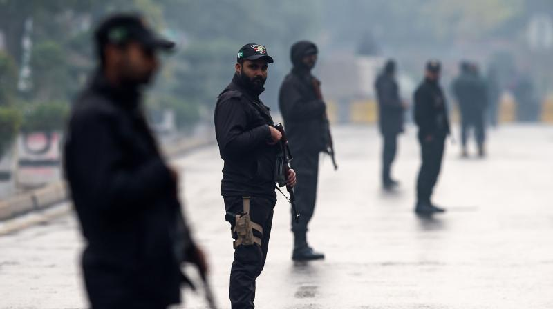Security personnel stand guard on a street near the Pindi Cricket Stadium before the start of the first day of the first Test cricket match between Pakistan and Sri Lanka in Rawalpindi on December 11, 2019. (Photo: AFP)