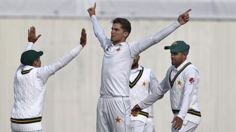 Pakistan's all-pace attack snared four key Sri Lankan wickets on Wednesday to buoy the crowd as Test cricket made its long-awaited return after a deadly attack in 2009. (Photo: AP)