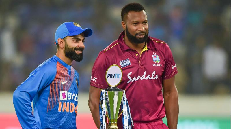 West Indies captain Kieron Pollard won the toss and elected to bowl first in the series decider against India. Virat Kohli and Co. will bat first. (Photo: PTI)