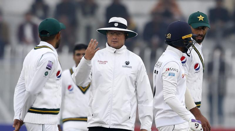 Pakistan's first home Test in a decade was affected by bad weather Friday, with rain and an already sodden pitch forcing officials to suspend play on the third day of the contest against Sri Lanka. (Photo: AP)