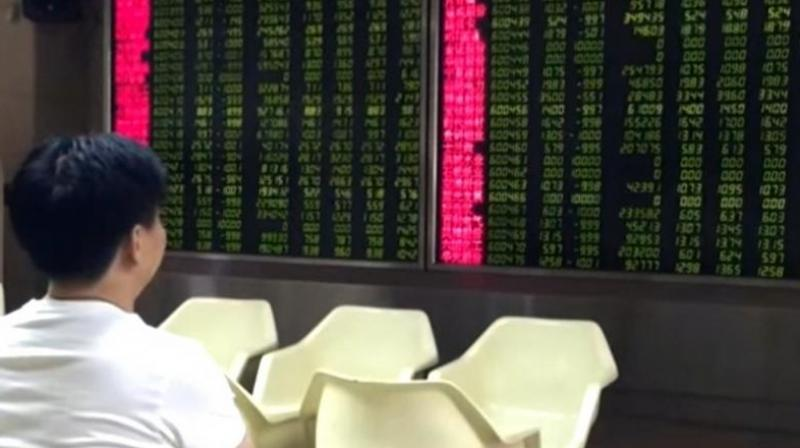 China's yuan, which had steadied on Wednesday, was again falling - dropping 0.2 per cent to 6.9871 per dollar.