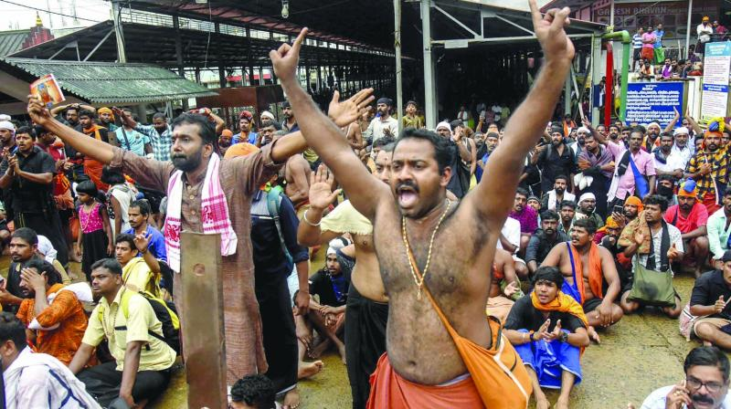 Protesters oppose the entry of women to the Sabarimala temple in Kerala. (Photo: PTI)