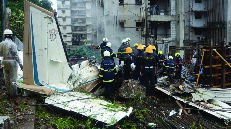 Forensic department personnel carry out investigations at the site of the plane crash in Mumbai. (Photo: Shripad Naik)