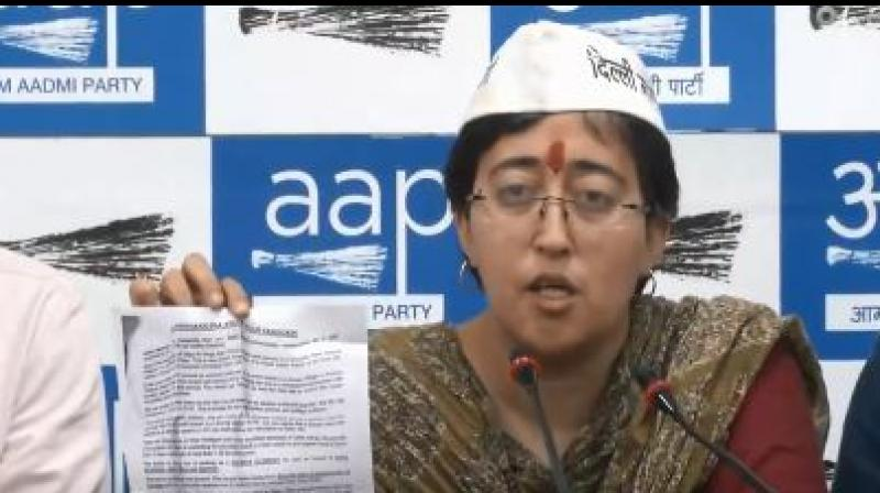 East Delhi Aam Aadmi Party (AAP) candidate Atishi on Thursday broke down while reading a pamphlet containing 'obscene and derogatory' remarks against her that she claimed has been distributed in the constituency by her BJP rival Gautam Gambhir. (Photo: screengrab/ ANI twitter)