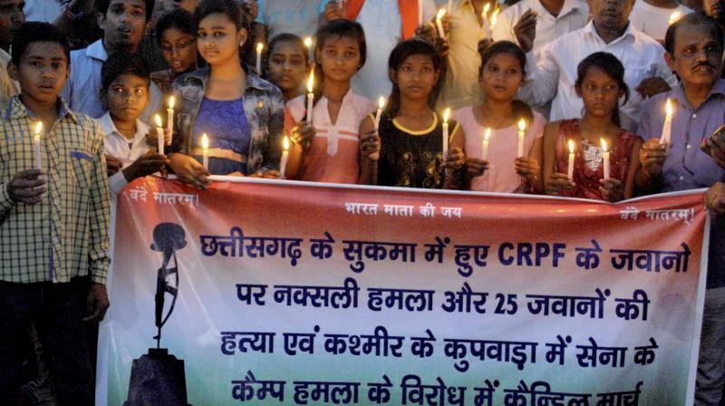 People and children at a candle light vigil in memory of the CRPF personnel, who were killed in the Sukma Naxal attack in Chattisgarh, in Patna. (Photo: PTI)