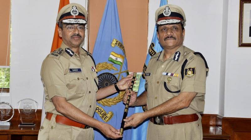 R.R. Bhatnagar (R) takes over the charge as the new Director General of CRPF in New Delhi. (Photo: PTI)