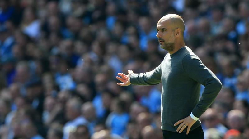 'It's a derby and all the times we play against United, the derbies are always special games and the players do their best for the fans and the club': Guardiola. (Photo: AFP)