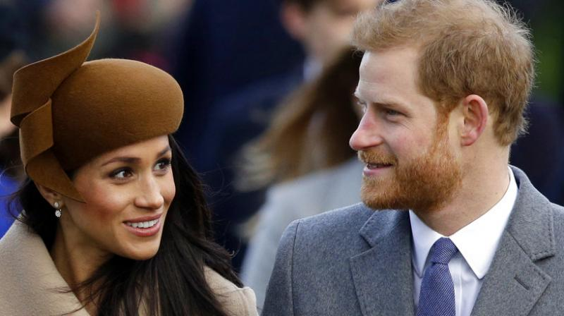 Britain's Prince Harry and his fiancee Meghan Markle arrive to attend the traditional Christmas Day service, at St. Mary Magdalene Church in Sandringham, England. (Photo: AP)