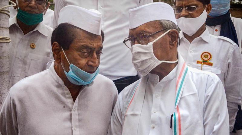 Madhya Pradesh Congress President Kamal Nath with senior leader and Rajya Sabha MP Digvijay Singh in Bhopal. — PTI photo