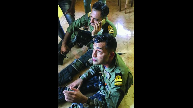 Pilots Captain M Sheokhand and Lieutenant Commander Deepak Yadav (right) after they managed to eject safely from their MiG-29K fighter jet that crashed shortly after it took off from INS Hansa in Goa on Saturday. (Photo: PTI)