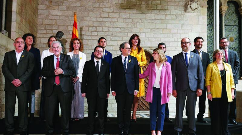 Catalonia's new regional government members pose after taking office during an official swearing-in ceremony at the Generalitat Palace in Barcelona on June 2, 2018. (Photo: AFP)
