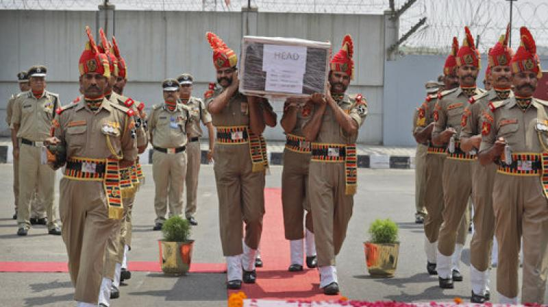 Indian Border Security Force soldiers carry the coffin of Prem Sagar during a ceremony to pay tributes in New Delhi. (Photo: AP)