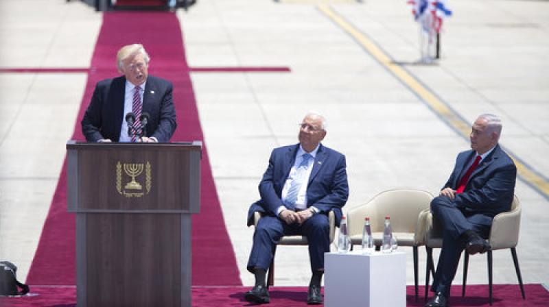 US President Donald Trump speaks during welcome ceremony in Tel Aviv, accompanied by Israel's President Reuven Rivlin, center, and Prime Minister Benjamin Netanyahu. (Photo: AP)